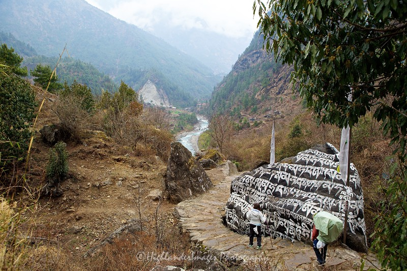 Mani stones and the beautiful Dudh Kosi River on the way up the Khumbu Valley to Phakding