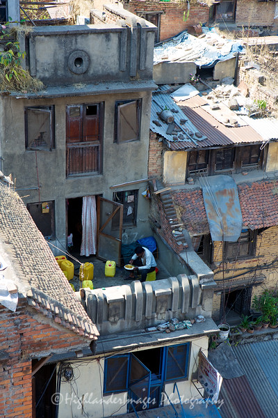 Having a meal on the balcony close to Durbar Square, Kathmandu.