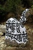 Beautifully painted Mani stones on the trail from Lukla to Phakding