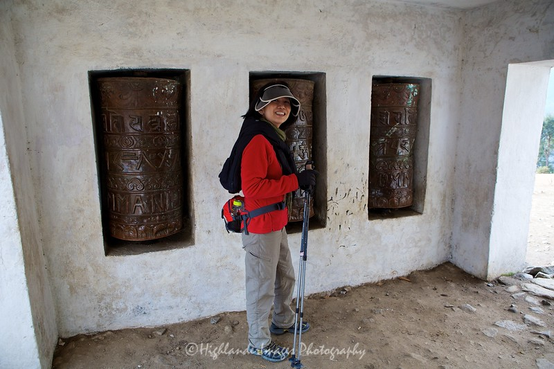 Suit Yoo starts the trek by spinning the prayer wheels at the outskirts of Lukal and heading towards Phakding