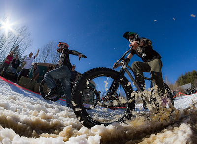 Competitors cross the finish line at the Winterbike Festival in Burke, Vermont