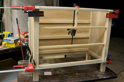 All the hard edges are gone, some sanding was done and now it's glued up and in the clamps!