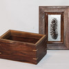 Walnut, maple, acrylic and pine cone