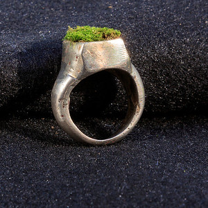 """Wyatt made this ring with his instructor Dan Newman. It's white bronze and it has a box on top for """"plantings"""". Here it's shown with yard moss.."""