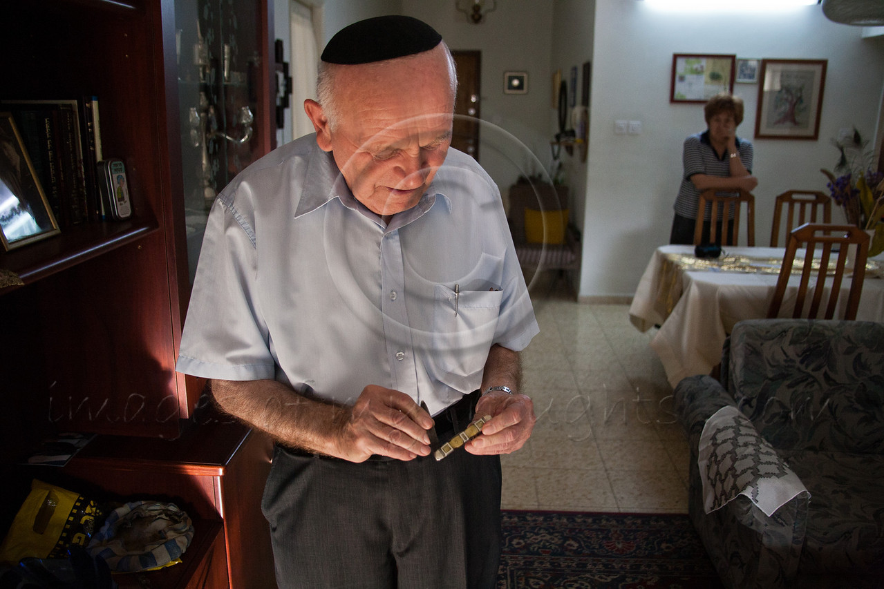 Yosef Kleinman, 82, Auschwitz-Birkenau, Dachau-Kaufering, survivor, displays a pocketknife he was able to smuggle and hide as a prisoner in the camps. He takes pride in documentation of the Holocaust through saved relics from the past. Jerusalem, Israel. 17-Apr-2012.