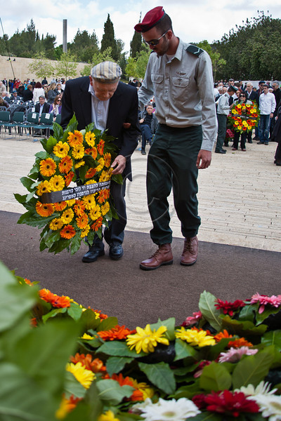 Yosef Kleinman, 82, lays a wreath on behalf of survivors of Dachau-Kaufering-Landsberg at Yad Vashem Holocaust Museum on Holocaust Martyrs' and Heroes' Remembrance Day, accompanied by his IDF-serving grandson. Jerusalem, Israel. 19-Apr-2012.