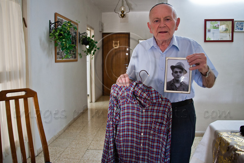 Yosef Kleinman, 82, Auschwitz-Birkenau, Dachau-Kaufering, survivor, displays a shirt given to him by a liberating American officer in April 1945 and a photo of himself wearing the same shirt taken 6 months later. Jerusalem, Israel. 17-Apr-2012.