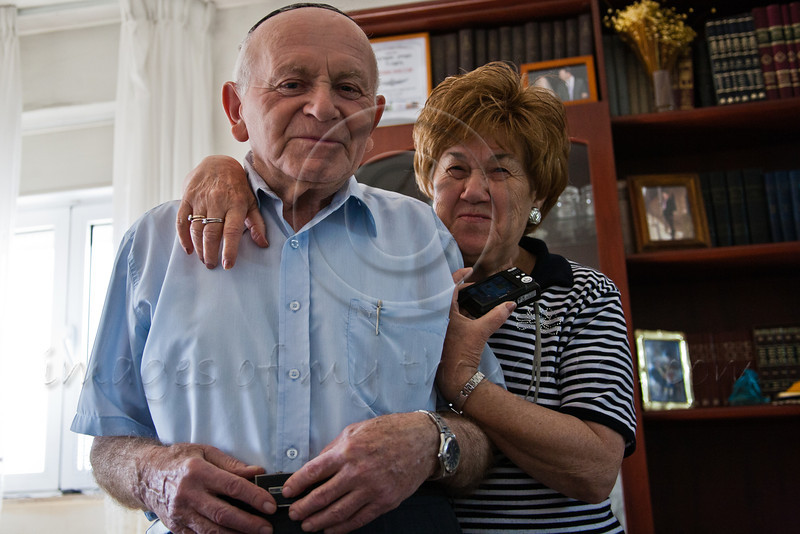 Yosef Kleinman, 82, Auschwitz-Birkenau, Dachau-Kaufering, Holocaust survivor, and supportive and admiring wife Chaya, at their home in Kiryat Moshe. Jerusalem, Israel. 17-Apr-2012.