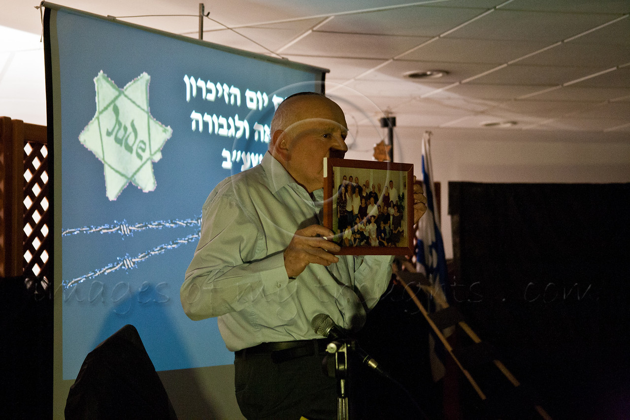 """Yosef Kleinman, 82, Holocaust survivor, displays a photo of his wife, children, grandchildren and great-grandchildren and announces """"This is my victory over the Nazis!"""" on the eve of Holocaust Martyrs' and Heroes' Remembrance Day. Bet-Shemesh, Israel. 18-Apr-2012."""