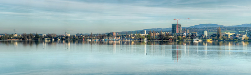 92 Megapixel Panorama in HDR of the city of Zug in Central Switzerland. Shot during early morning hours about 1 hour after sunrise.