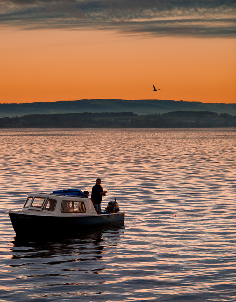 Fisherman before Sunset on Zugersee / Central Switzerland
