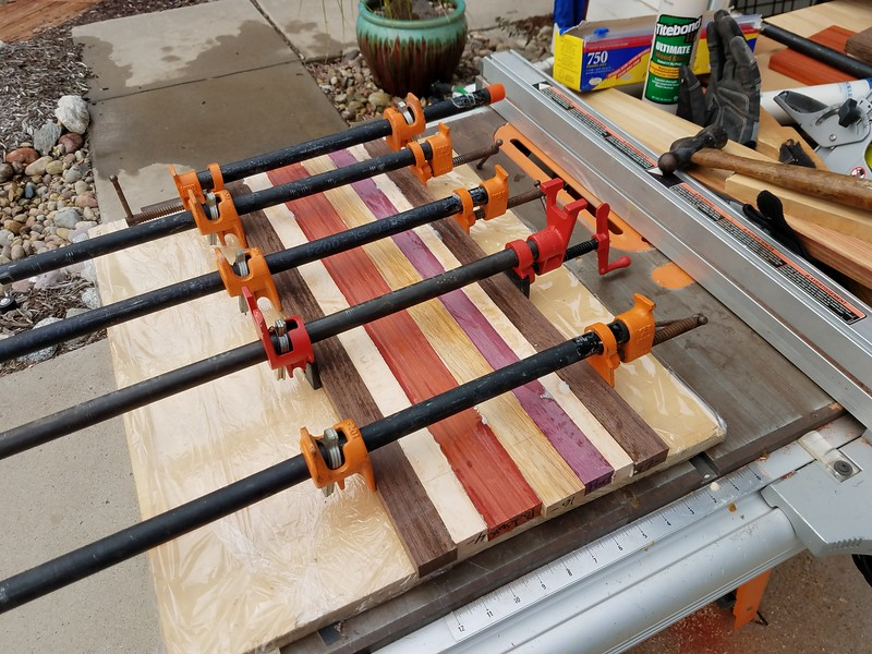 Gluing up a cutting board.<br /> Wenge<br /> Curly Maple<br /> Padouk<br /> Canary Wood<br /> Purple Heart<br /> Curly Maple<br /> Wenge