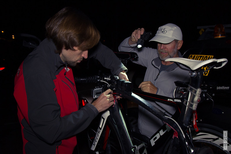 Crew member Nick, and Crew Chief Barrie make final adjustments to the bicycles.