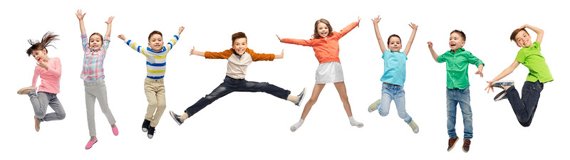 happy kids jumping in air over white background