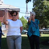 Breathing deeply, each woman performs the form precisely at the tai chi class at the Billerica Council on Aging -- photo by Mary Leach