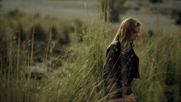 Girl walking in tall grass 16