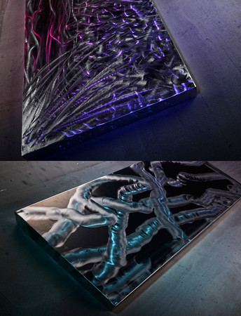 Adding color with light to metal art.