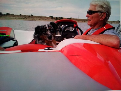 "mini-Aussie ""Smoke"" with owner on works Seadoo 150 Speedster on Lake Pueblo, Colorado."