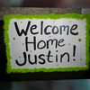 """Click gray and white arrow to start the photo video show """"Justin's Homecoming"""""""