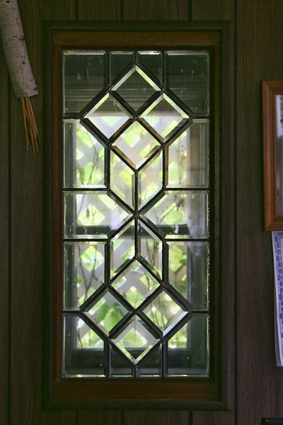 This window in the office of the Nunberg home was originally on the west side of the house, looking out onto a screened porch. It was relocated when the home was remodeled in the 60s, an addition constructed on the west and the east-facing basement entry added.