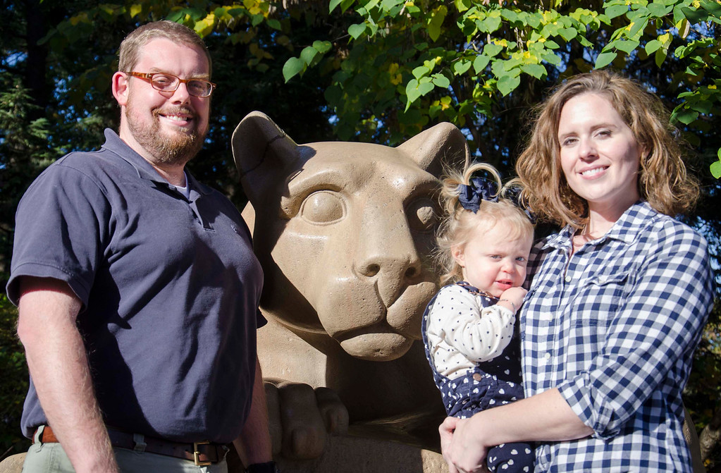 Jonathan and April Schnibben and their daughter, McKinney, at the Lion Shrine on Oct. 19, 2014.