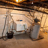Sump pump, cistern holding tank on other side of wall