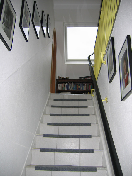 Stairway going up to 2nd floor.  The bedrooms upstairs are in the 4 corners.