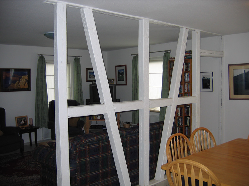 This shows some of the family room.  The white beams are original support beams that had to be left in place when they renovated and made this a one family home from a 2 family home.