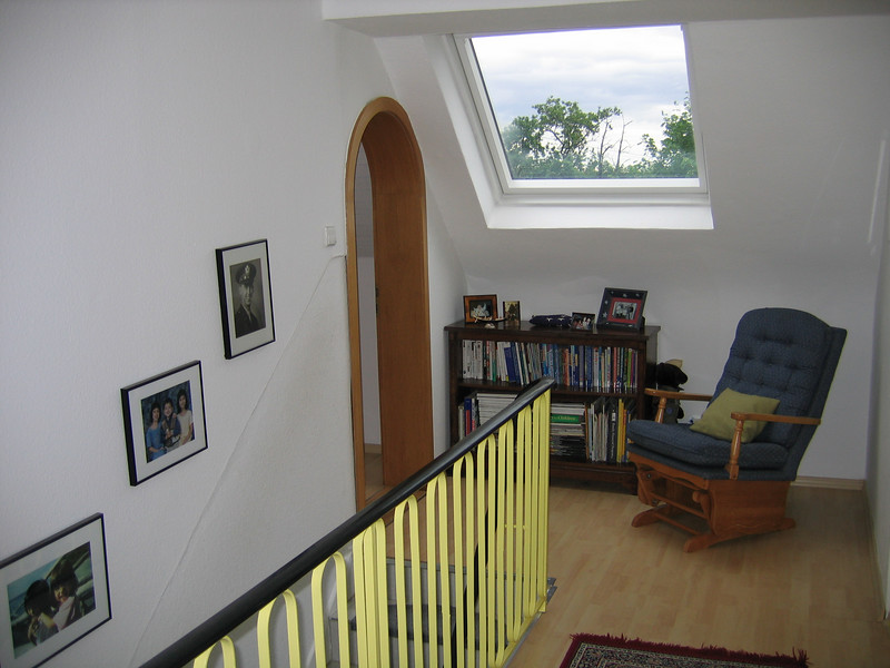 View from back hallway looking towards top of staircase.  Notice the large sky window providing lots of natural light year round.