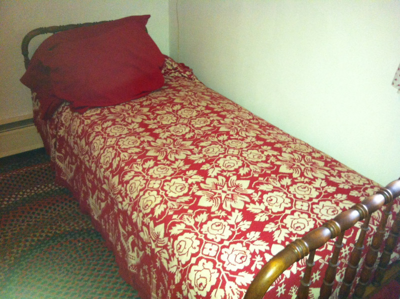 Bed in 2nd floor bedroom on left