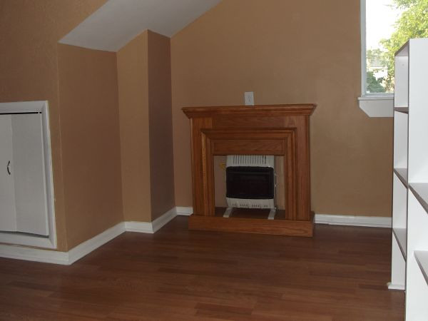 The studio-efficiency on the 3rd floor has an oak mantle with gas heater for use in the winter.