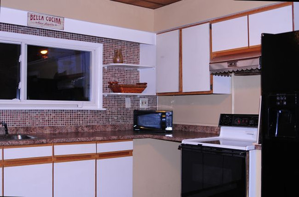 The second-floor kitchen has a gas stove, Jenn-Air refrigerator and dishwasher.