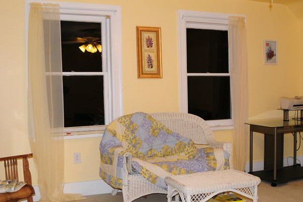 Front room. These windows look out over Bellevue and the Ohio River Valley. Ceiling light fixture has multi-speed fan.