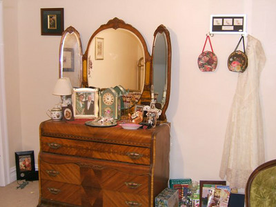 Antique dresser and mirror in bedroom.
