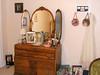 Antique dresser and mirror in bedroom.