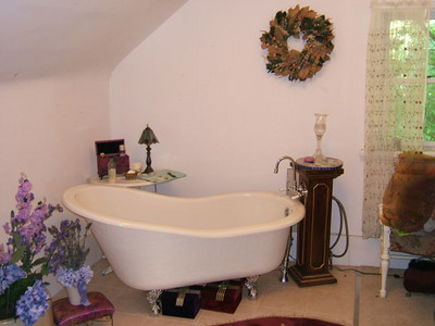Slipper tub in bath room - located in back of house and accessed through the bedroom.