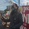 """A protestor stands in front of the barricades on the Port of Olympia's rail line.  Protestors built this barricade and camp to prevent the port from shipping """"proppants"""" (francking sands) to the Bakken oil fields of North Dakota.  This was done in solidarity  in solidarity with the Standing Rock Sioux who are protesting the construction of the Dakota Access Pipeline."""