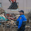 BNSF railway police looks on as tracks are cleared of debris after the Olympia Stands protest camp was removed.