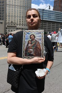 Faiaza Shamoon of Chicago brought a picture of Jesus and St. Joseph to the rally. Several of her cousins are detainees, she said. Photo by Aileen WIngblad / Digital First Media.