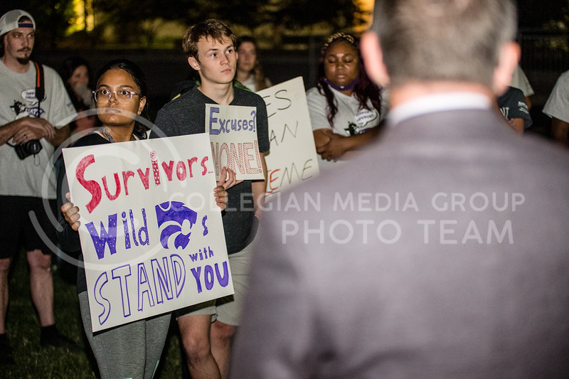K-State President, Richard Myers, and Vice President for Student Life and Dean of Students, Thomas Lane, meet with  students and alumni over concerns on bodily autonomy and title 9 allegations outside Myers residence. (Dylan Connell   Collegian Media Group)