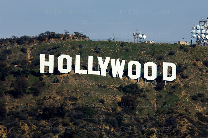 """Protesters are covering the world-famous Hollywood sign with panels reading """"Save the Peak."""" The group has raised about $7 million of the roughly $12 million needed to buy the Cahuenga Peak property from the Chicago area-based owners. The owners had announced plans to develop the 138-acre parcel into luxury homes."""