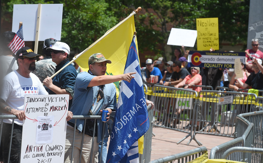 """. Proud Boys members and others are chanting in front of the Pearl Street courthouse. The Proud Boys, a far right group, held a \""""free speech\"""" event on Saturday on the Pearl Street Mall. They were countered with anti-Trump protesters among others. For more photos and a video, go to www.dailycamera.com.  Cliff Grassmick  Staff Photographer June 3, 2017"""