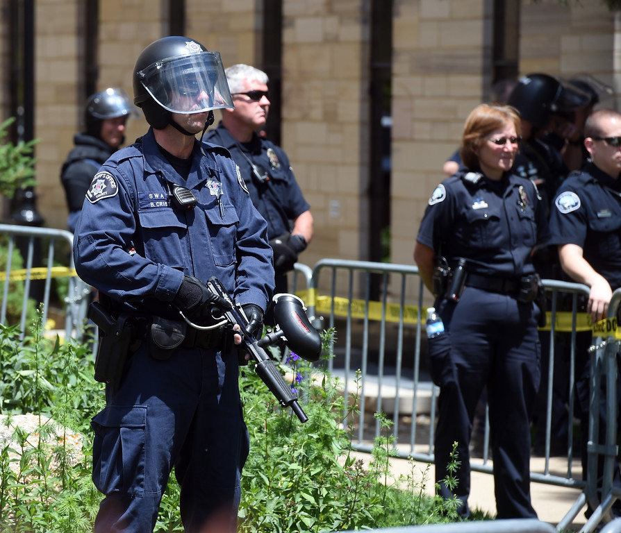 """. A strong police presence was seen at the protest. The Proud Boys, a far right group, held a \""""free speech\"""" event on Saturday on the Pearl Street Mall. They were countered with anti-Trump protesters among others. For more photos and a video, go to www.dailycamera.com.  Cliff Grassmick  Staff Photographer June 3, 2017"""