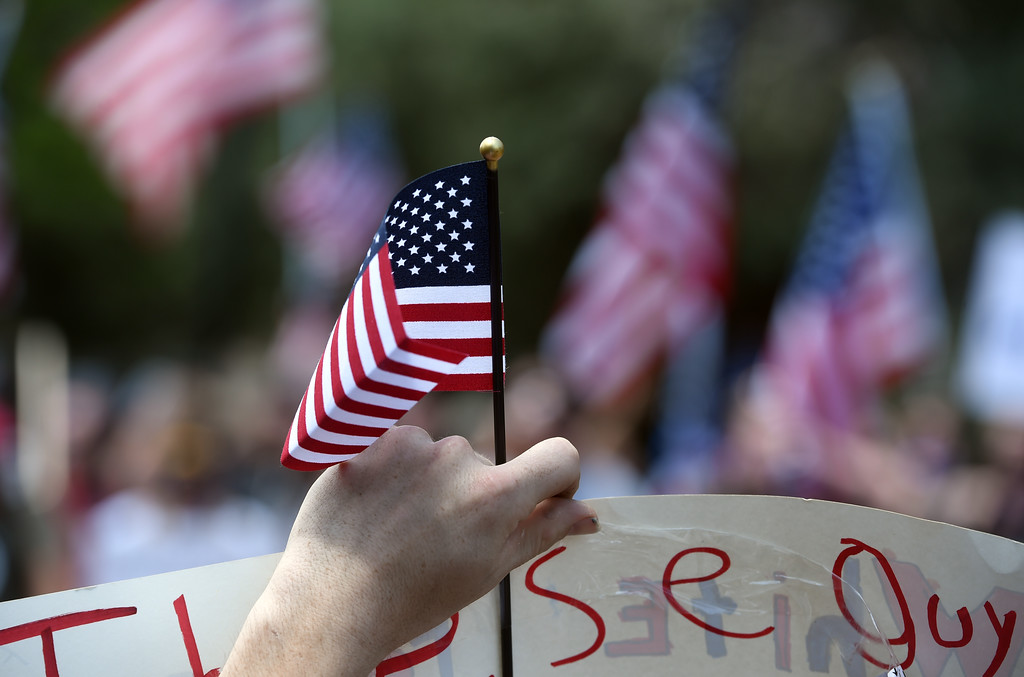 """. The flag of counterprotesters can be seen with the Proud Boys in the background. The Proud Boys, a far right group, held a \""""free speech\"""" event on Saturday on the Pearl Street Mall. They were countered with anti-Trump protesters among others. At least four people were detained today at a rally on Boulder\'s Pearl Street Mall at which about two dozen members of a self-described \""""western chauvinist\"""" group were met by roughly 200 counterprotesters.  Cliff Grassmick  Staff Photographer June 3, 2017"""