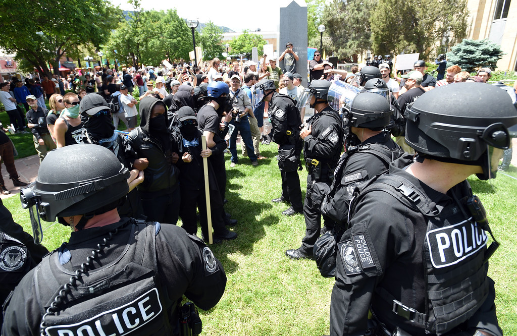 """. People dressed in black were among the counterprotesters at the event. The Proud Boys, a far right group, held a \""""free speech\"""" event on Saturday on the Pearl Street Mall. They were countered with anti-Trump protesters among others. For more photos and a video, go to www.dailycamera.com.  Cliff Grassmick  Staff Photographer June 3, 2017"""