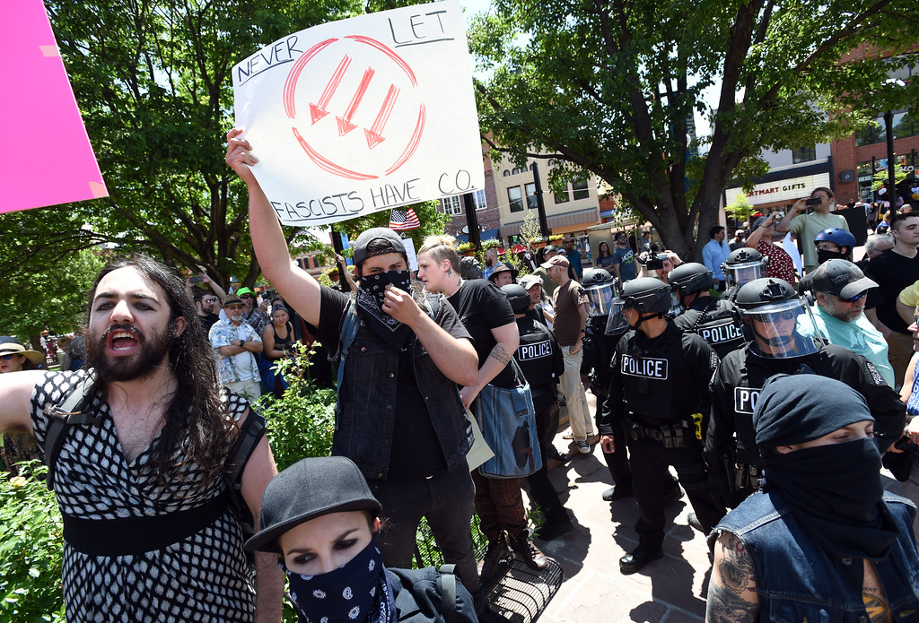 """. Counterprotesters hold up signs for the Proud Boys.  The Proud Boys, a far right group, held a \""""free speech\"""" event on Saturday on the Pearl Street Mall. They were countered with anti-Trump protesters among others. For more photos and a video, go to www.dailycamera.com.  Cliff Grassmick  Staff Photographer June 3, 2017"""