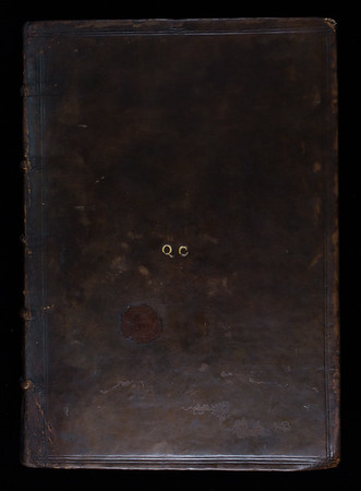 Binding with gilt-stamped initials of Queens' College, 17th century