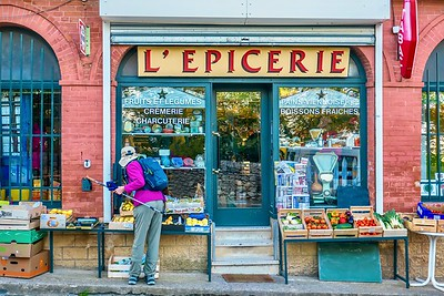 "Shopping at a traditional ""mom & pop"" grocery shop in Provence."