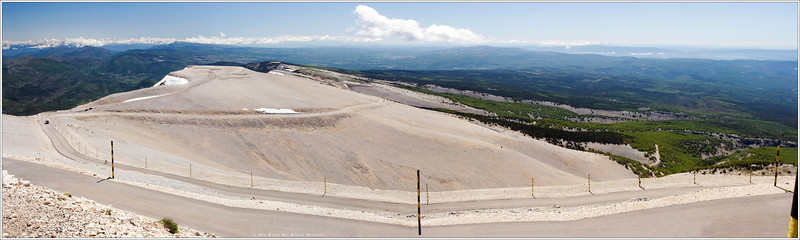 """The view back down the mountain road that brought us to the top of Ventoux. The whitewashed rock, totally baron except for the heartiest of weeds, accentuated that """"top of the world"""" feeling at an altitude of more than 6270 feet."""