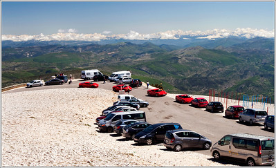 As if the view atop Mt. Ventoux needed accessorizing... from the back side of the mountain a line of more than a dozen humming Ferrari's announced their arrival and quickly captured onlooker's attention.